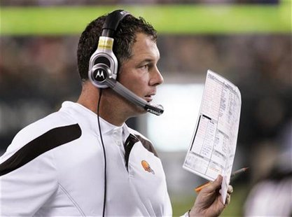 Cleveland Browns head coach Pat Shurmur calls in a play during the first half of a pre-season exhibition football game with the Philadelphia