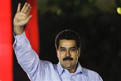 Venezuela's Vice President Nicolas Maduro greets supporters during the anniversary ceremony of the Bolivarian Alliance for the Peoples of Ou
