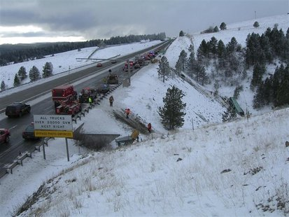 Rescue personnel respond to the scene of a charter bus crash on I-84, east of Pendleton, Oregon in this December 30, 2012 handout photo. REU