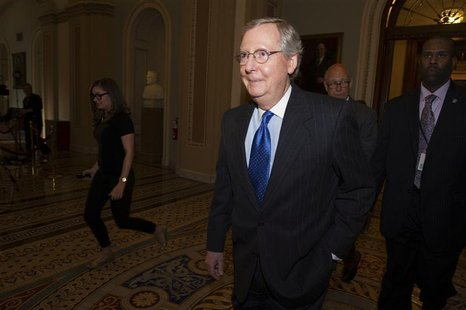 U.S. Senate Minority Leader Mitch McConnell (R-KY) leaves the Senate Chamber for the caucus at the U.S. Capitol in Washington December 30, 2
