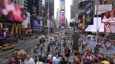 Tourists gather in Times Square in New York August 6, 2012. REUTERS/Charles Platiau