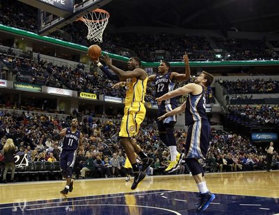 Indiana Pacers center Roy Hibbert puts up a shot defended by Memphis Grizzlies guard Mike Conley (L), Grizzlies forward Rudy Gay (2nd R) and