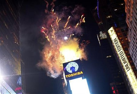 Fireworks explode over Times Square as the crystal ball is hoisted before New Year celebrations in New York December 31, 2012. REUTERS/Joshu