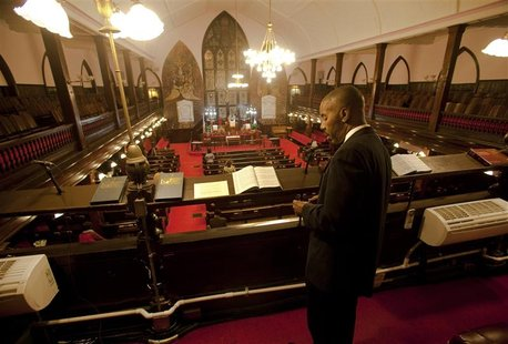 LaMonte Thomas of North Charleston, South Carolina, stands in the choir balcony just before the start of the Watch Night service at Emanuel