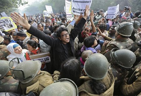 Demonstrators shout slogans as they are surrounded by the police during a protest rally in New Delhi in this December 27, 2012 file photo. B