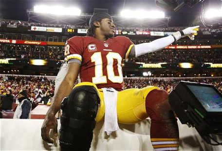 Washington Redskins quarterback Robert Griffin III (10) celebrates on the bench after his team beat the Dallas Cowboys during their NFL foot