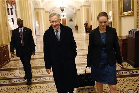 U.S. Senate Majority Leader Harry Reid (D-NV) (center) departs with an aide, after a senate vote in the early morning hours, from the U.S. Capitol in Washington January 1, 2013. Credit: REUTERS/Jonathan Ernst
