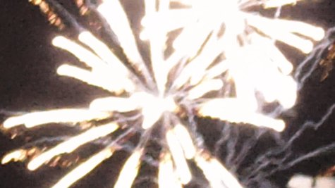 Fireworks exploding over the Kalamazoo Mall just seconds after midnight.