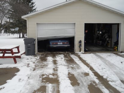 The Blue Riviera can be seen inside the garage where it ended up after crashing through the closed door.