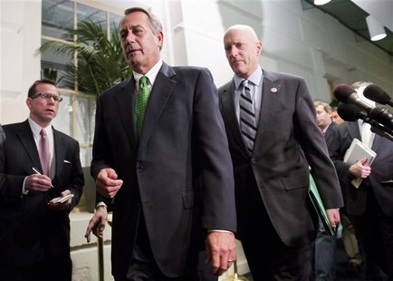 Speaker of the House John Boehner (R-OH) (front, in green tie) walks with Congressman Dave Camp (R-MI) (R) after a meeting with House Republ