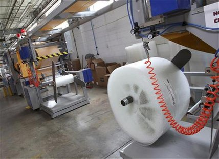 A machine that makes bubble wrap padded envelopes is pictured at the Wrap-Tite manufacturing facility in Solon, Ohio July 13, 2012. REUTERS/