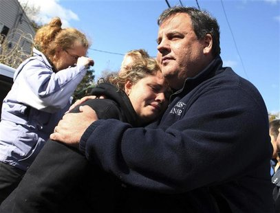 New Jersey Governor Chris Christie comforts Kerri Berean whose home was damaged by Hurricane Sandy in Little Ferry, New Jersey, November 3,