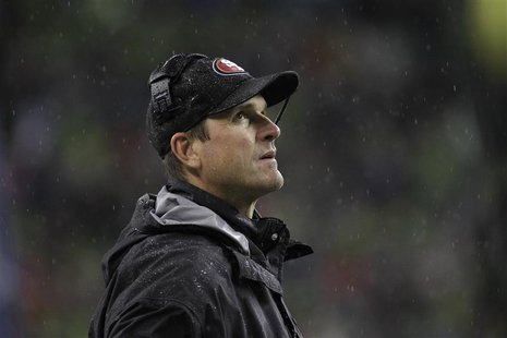 San Francisco 49ers head coach Jim Harbaugh looks on from the sidelines during the first quarter of their NFL football game against the Seat