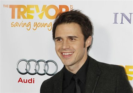 "Singer Kris Allen arrives at The Trevor Project's ""Trevor Live"" fundraising dinner in Hollywood December 4, 2011. REUTERS/Fred Prouser"