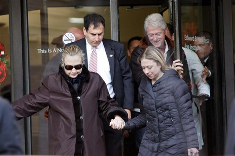 U.S. Secretary of State Hillary Clinton leaves New York Presbyterian Hospital with husband, Bill (TOP R), and daughter, Chelsea (R), in New