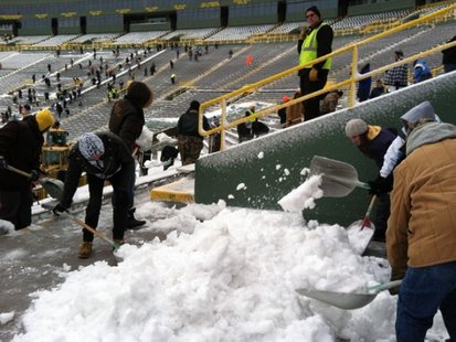 Snow shovelers in Lambeau Field bowl.  (Photo Courtesy of Fox 11 WLUK-TV)