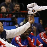 Detroit Pistons forward Charlie Villanueva tosses a towel while sitting on the bench during the second half of their NBA basketball game aga
