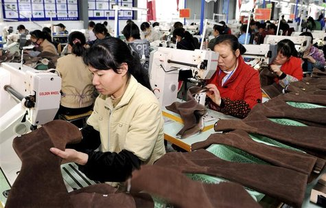 Employees work at a shoe factory in Dongkou county, Hunan province April 5, 2012. REUTERS/China Daily