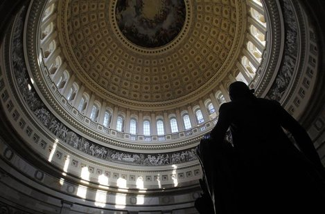 A statue of the United States first President, George Washington, is seen under the Capitol dome in Washington January 2, 2013. REUTERS/Gary