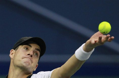 John Isner of the U.S. serves to South Africa's Kevin Anderson during the men's singles match at the Shanghai Masters tennis tournament in S