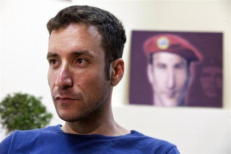 Itzik Shmuli, head of the National Student Union and one of the leaders of Israel's social protest movement, is seen during an interview wit