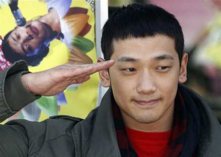 South Korean pop singer Rain salutes his fans before he joins the army in front of an army recruit training centre in Uijeongbu, north of Se