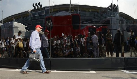 Former Austrian Formula One World Champion Niki Lauda walks in the paddock after the Italian F1 Grand Prix at the Monza circuit September 9,