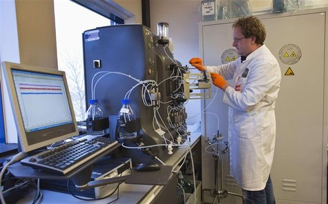 An operator installs a chromatography column to purify the gene therapy drug Glybera at Dutch biotech company uniQure in Amsterdam December