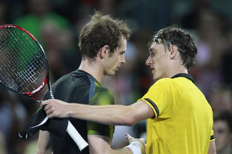 Andy Murray of Britain greets John Millman of Australia after their men's singles match at the Brisbane International tennis tournament Janu