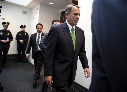 "Speaker of the House John Boehner (R-OH) walks from a meeting with House Republicans about a solution for the ""fiscal cliff"" on Capitol Hill"