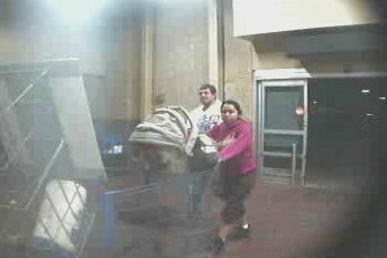 The suspect is seen with a young girl and an infant outside the Walmart store.