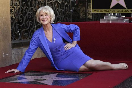 Helen Mirren poses with her newly-unveiled star, the 2,488th star on the Hollywood Walk of Fame, in Hollywood, California, January 3, 2013.