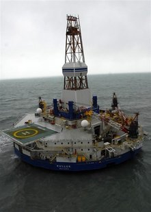 The conical drilling unit Kulluk, owned by Royal Dutch/Shell, sits aground 40 miles (64 kms) southwest of Kodiak City, Alaska, on the shore