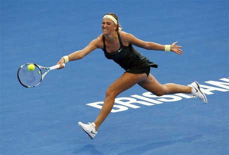 Victoria Azarenka of Belarus hits a return to Ksenia Pervak of Kazakhstan during their women's singles match at the Brisbane International t