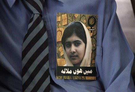 A Pakistani student, with a portrait of Malala Yousufzai on his shirt, attends a meeting organized by South Asian Women in Media to mark Mal