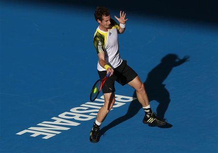 Andy Murray of Britain hits a return to Denis Istomin of Uzbekistan during their men's singles match at the Brisbane International tennis to