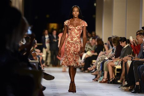 Model Naomi Campbell walks down the runway as she presents a creation from the Zac Posen Spring/Summer 2013 collection during New York Fashi