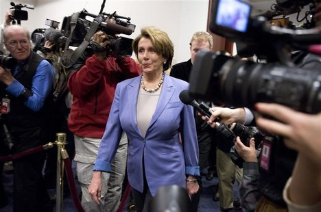 U.S. House Minority Leader Nancy Pelosi (D-CA) arrives to meet with House Democrats and U.S. Vice President Joseph Biden about a solution fo
