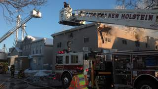 Fire crews battle blaze at apartment building on Railroad Street in New Holstein on Friday January 4, 2012. (courtesy of FOX 11).