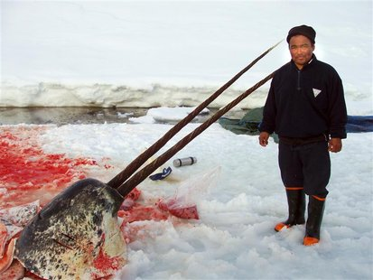File photo dated May 12, 2007 shows sealer Aron Aqqaluk Kristiansen from the Kangersuatsiaq, Upernavik commune in Greenland posing with the