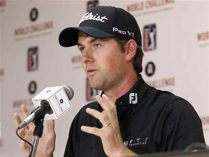 PGA golfer Webb Simpson gestures as he answers a question about using a long putter during a media conference at the World Challenge golf to
