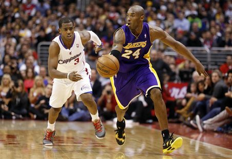 Los Angeles Lakers' Kobe Bryant (R) drives past Los Angeles Clippers' Chris Paul during the second half of their NBA basketball game in Los