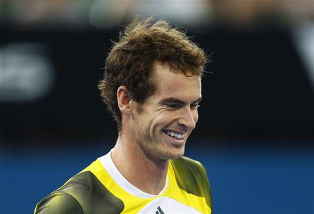 Andy Murray of Britain smiles during his men's singles semi-final match against Kei Nishikori of Japan at the Brisbane International tennis