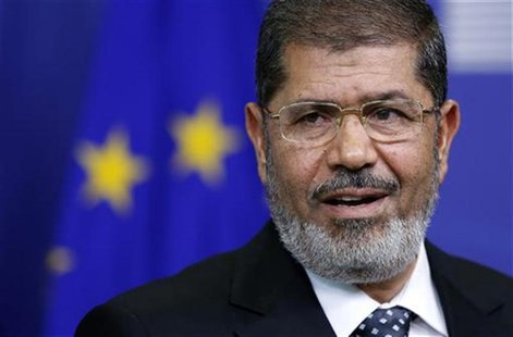 Egypt's President Mohamed Mursi answers reporters' questions after meeting European Commission President Jose Manuel Barroso (unseen) at the