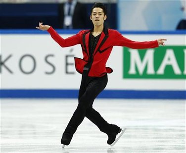 Daisuke Takahashi of Japan performs during the men's short programme at the ISU Grand Prix of Figure Skating Final in Sochi December 7, 2012