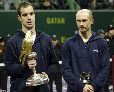 France's Richard Gasquet holds his trophy after he won the final against Nikolay Davydenko of Russia (R) at the Qatar Open in Doha January 5