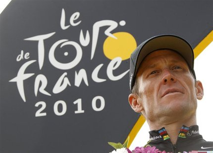 Radioshack team rider Lance Armstrong of the U.S. poses on the podium in Paris after the final 20th stage of the 97th Tour de France cycling