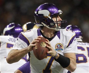 Minnesota Vikings quarterback Christian Ponder looks for a pass during the first half of their NFL football game against the St. Louis Rams