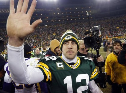 Green Bay Packers quarterback Aaron Rodgers (12) waves to fans after defeating the Minnesota Vikings in their NFL NFC wildcard playoff footb