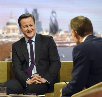 Britain's Prime Minister David Cameron (L) speaks on the BBC's Andrew Marr Show in London January 6, 2013. REUTERS/Jeff Overs/BBC/Handout